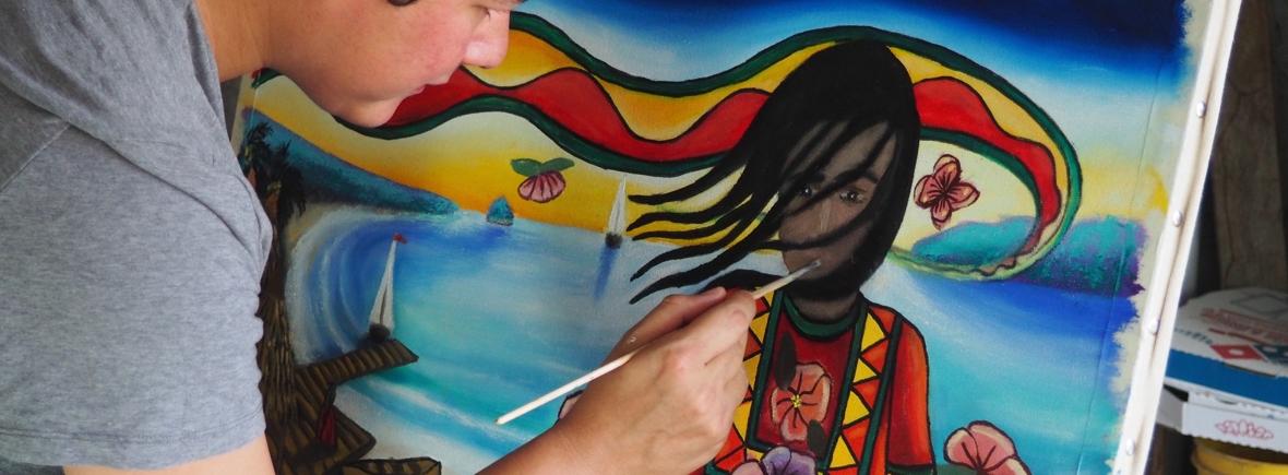 Image of Efraín painting La Niña del Tropico